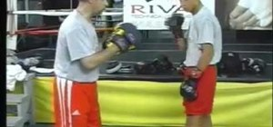 Defend against a left hook in boxing