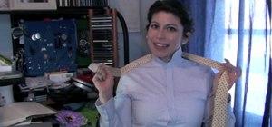 Tie a necktie in a windsor or half windsor knot