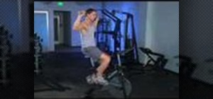 Workout with dumbbell up rotators on a spin bike