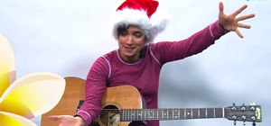 "Play ""White Christmas"" by Irving Berlin on the guitar"