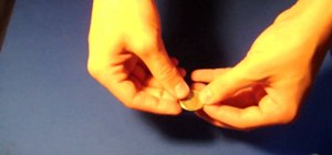 "Perform the ""coin bend"" magic trick"