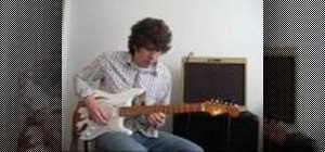 Play blues licks on electric guitar