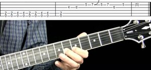 Play two signature Blues licks on the guitar