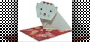 Origami a cat on a square cushion Japanese style