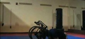 Take down an aggressor for wheelchair bound defense