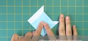 Fold a simple origami sailboat with one sheet of paper