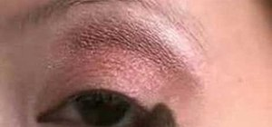 Apply brown and teal eye makeup