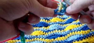 Crochet the start of a wavy shell pattern blanket