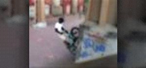 Perform a walltap on a BMX bicycle