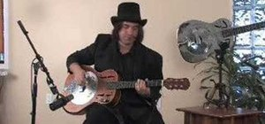 Play a Delta Blues style progression on a resonator guitar