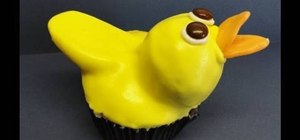 Decorate rubber ducky shaped cupcakes