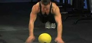 Use a medicine ball for plank hop ups and down