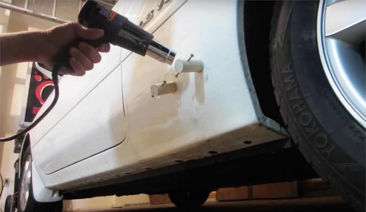 How to Fix a Huge Dent in Your Car at Home Without Ruining the Paint Job