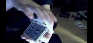 Perform a one-handed aerial launch magic card trick