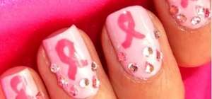Create a rhinestone-studded pink Breast Cancer Awareness nail design