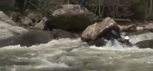 Deal with rocks in whitewater race kayaking