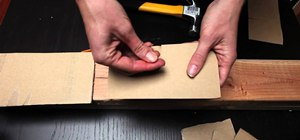 Hammer a nail safely and hold your nail in place with cardboard
