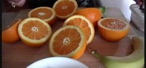 Make a orange, strawberry, banana, and lime smoothie