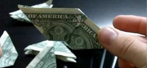 Fold an eight-sided origami frisbee with dollar bills