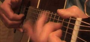 "Play ""Driftin' Blues"" on acoustic guitar"