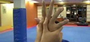 Perform a front hair grab release for self-defense